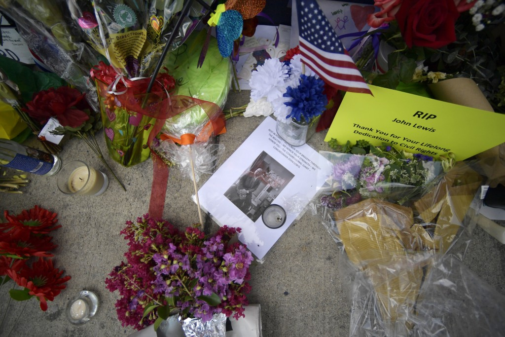 Flowers and other mementos are seen at a make-shift memorial near the home of Rep. John Lewis, D-Ga., Sunday, July 19, 2020, in Atlanta. Lewis, who di...