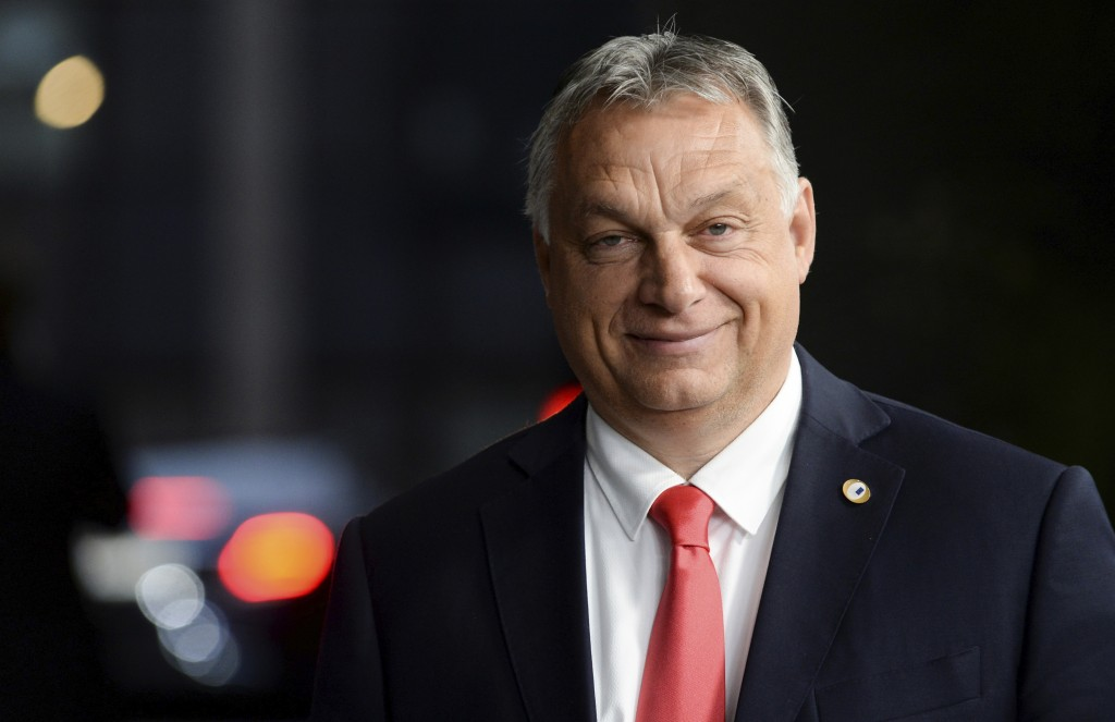 Hungary's Prime Minister Viktor Orban leaves the EU Council building early in the morning during an EU summit in Brussels, Monday, July 20, 2020. Lead...
