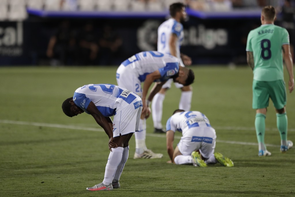 Leganes' players react after the Spanish La Liga soccer match between Leganes and Real Madrid at the Butarque Stadium in Leganes, on the outskirts of ...
