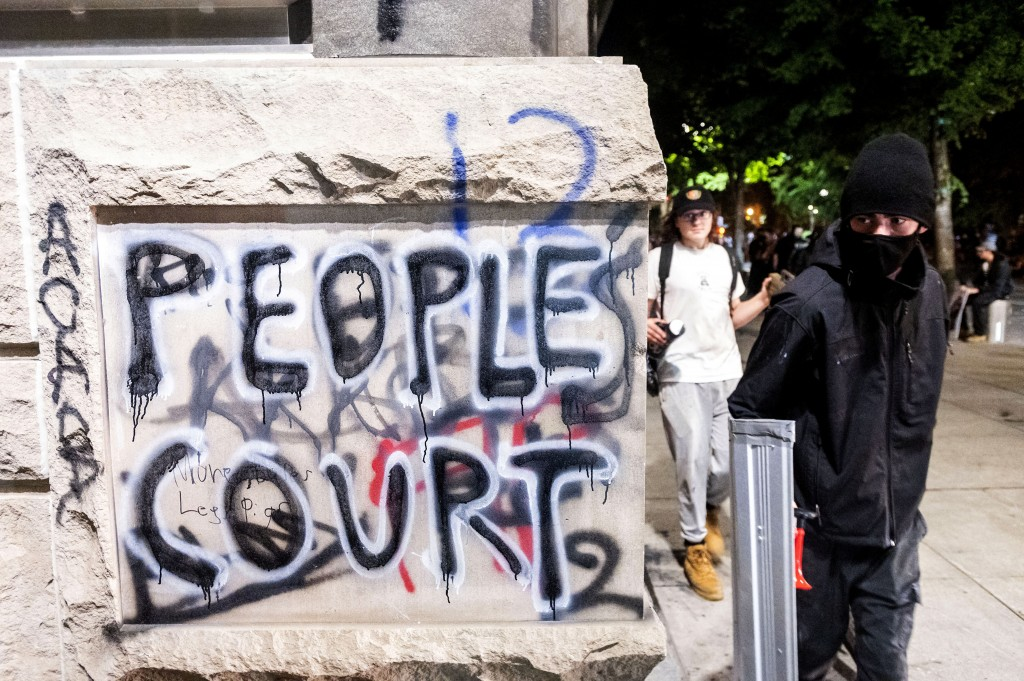 Grafitti is shown during a Black Lives Matter protest outside Mark O. Hatfield United States Courthouse on Monday, July 20, 2020, in Portland, Ore. Po...