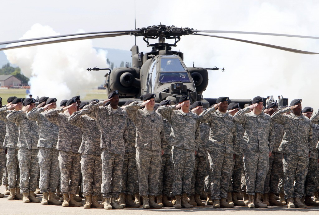 FILE - In this Friday, May 13, 2011 file photo, Soldiers of 1AD attend a color casing ceremony of the First Armored Division at the US Army Airfield i...