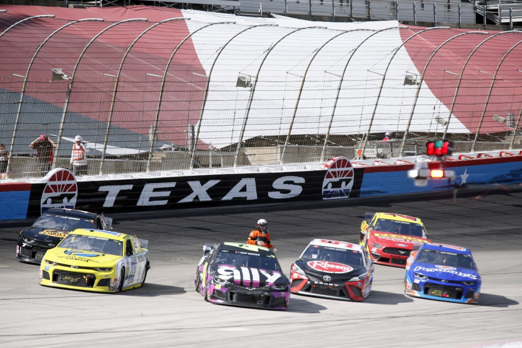 A NASCAR official checks drivers as the race was red flagged for over 11 minutes due to an 11-car incident  during a NASCAR Cup Series auto race at Te...