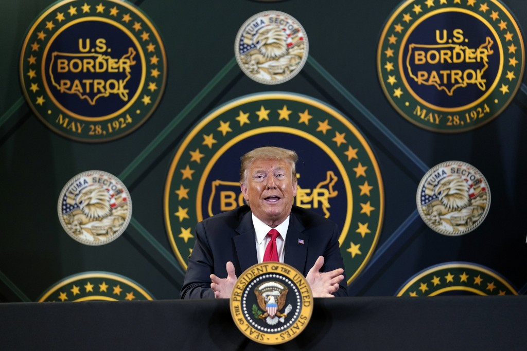 FILE - In this June 23, 2020, file photo President Donald Trump participates in a border security briefing at United States Border Patrol Yuma Station...