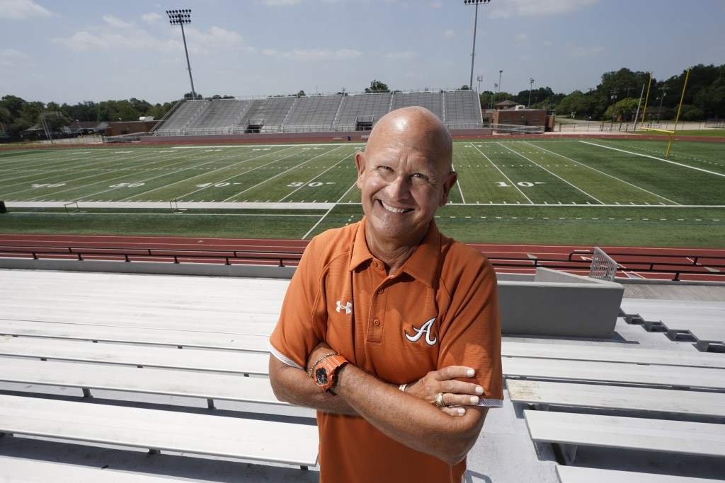 Alvin High School football coach Tim Teykl poses inside Alvin Memorial Stadium Tuesday, July 14, 2020, in Alvin, Texas. The overwhelming uncertainty o...