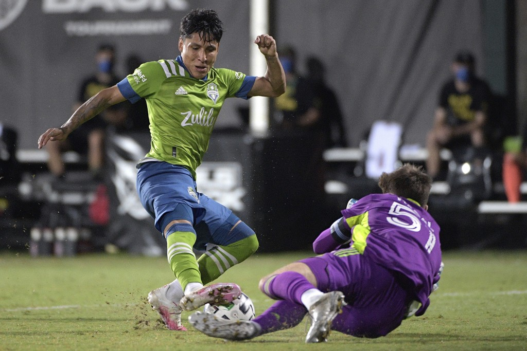Seattle Sounders forward Raul Ruidiaz (9) has his shot blocked by Vancouver Whitecaps goalkeeper Thomas Hasal (51) during the second half of an MLS so...