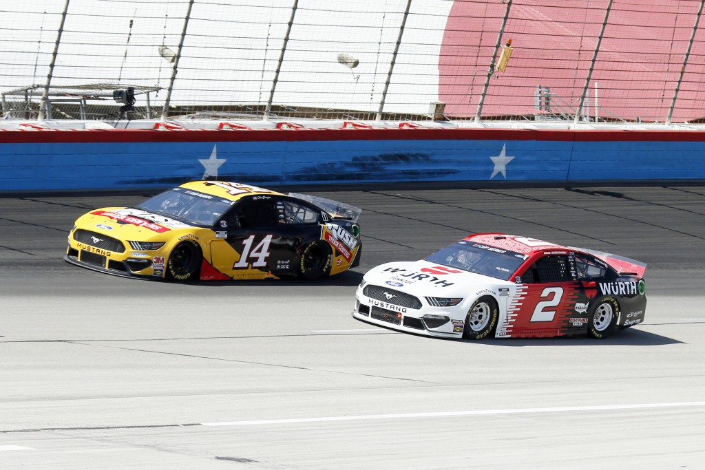 Clint Bowyer (14) and Brad Keselowski (2) come out of Turn 4 during a NASCAR Cup Series auto race at Texas Motor Speedway in Fort Worth, Texas, Sunday...