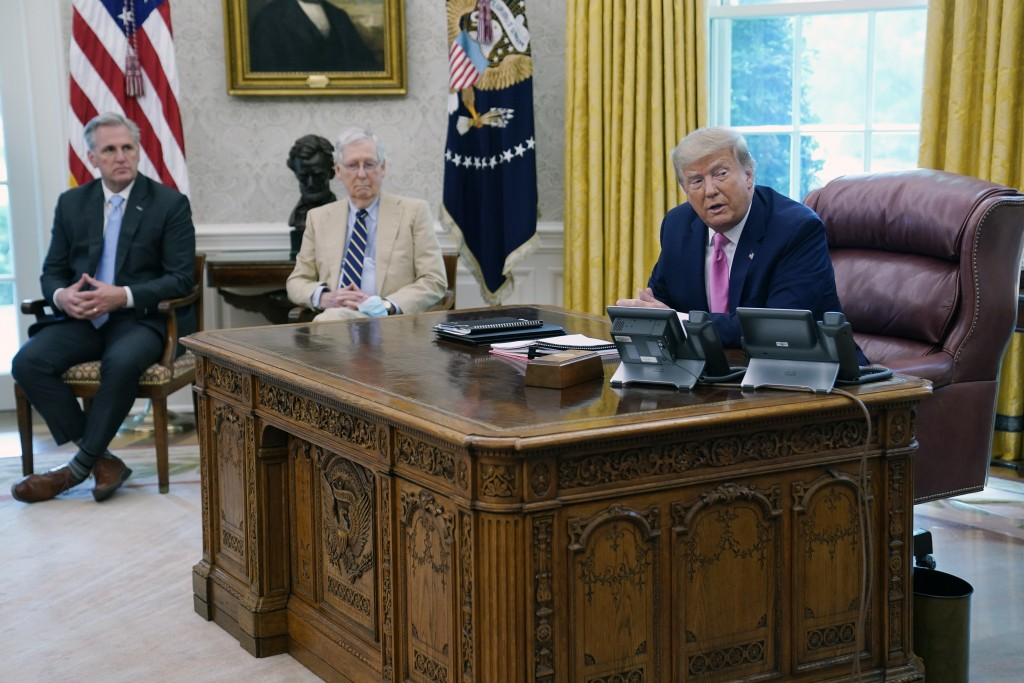 President Donald Trump meets with Senate Majority Leader Mitch McConnell, center, and House Minority Leader Kevin McCarthy in the Oval Office at the W...
