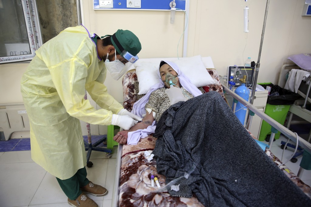 A patient is connected to an oxygen tank in the Intensive Care Unit ward for COVID-19 patients at the Afghan-Japan Communicable Disease Hospital in Ka...