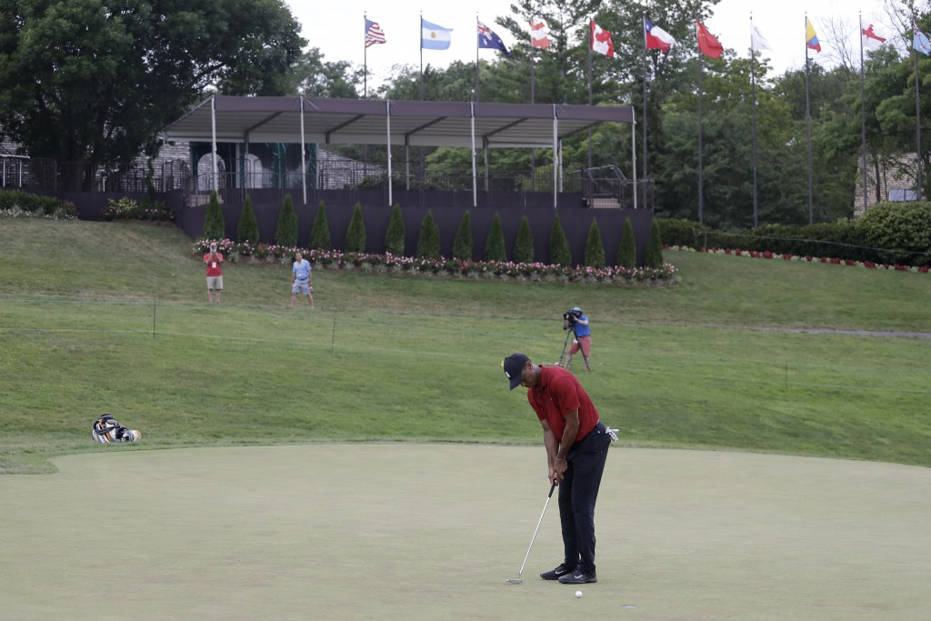 Tiger Woods putts on the 18th green during the final round of the Memorial golf tournament, Sunday, July 19, 2020, in Dublin, Ohio. (AP Photo/Darron C...