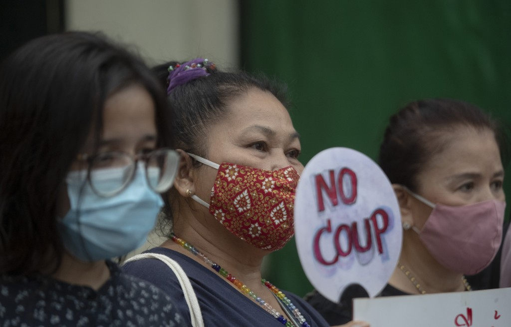Thai anti-government protesters gather in front of the Royal Thai Army Headquarters in Bangkok, Thailand, Monday, July 20, 2020. Anti-government prote...