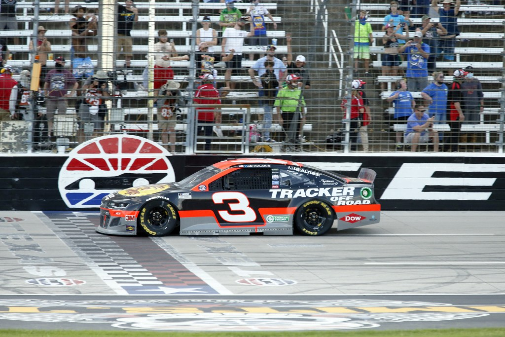 Austin Dillon crosses the finish line to win the NASCAR Cup Series auto race at Texas Motor Speedway in Fort Worth, Texas, Sunday, July 19, 2020. (AP ...