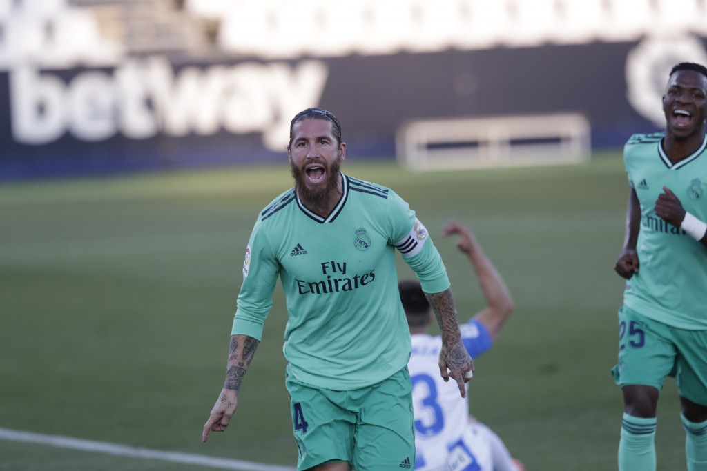 Real Madrid's captain Sergio Ramos celebrates after scoring during the Spanish La Liga soccer match between Leganes and Real Madrid at the Butarque St...