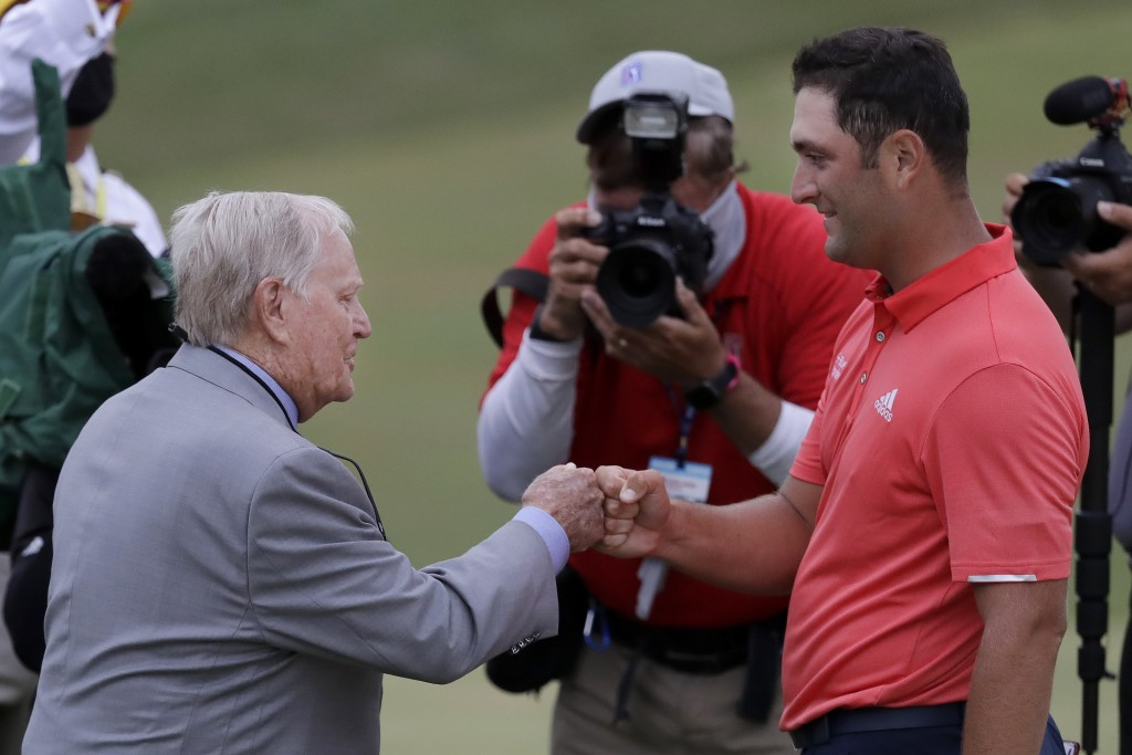 Jon Rahm, of Spain, right, is congratulated by Jack Nicklaus after winning the Memorial golf tournament, Sunday, July 19, 2020, in Dublin, Ohio. (AP P...