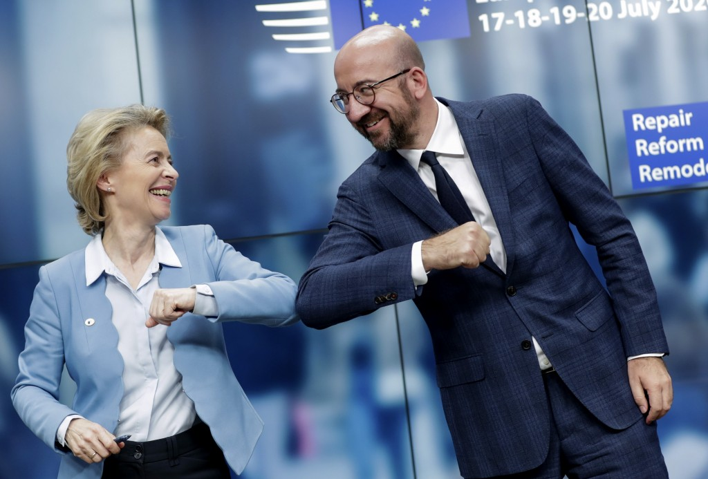 European Commission President Ursula von der Leyen, left, and European Council President Charles Michel bump elbows after addressing a media conferenc...