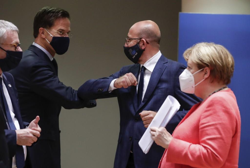 Dutch Prime Minister Mark Rutte, center left, elbow bumps with European Council President Charles Michel, center right, as German Chancellor Angela Me...