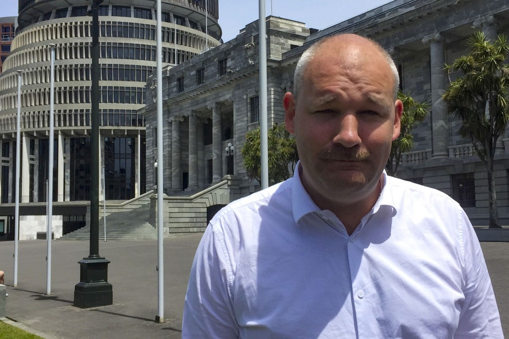 Former National MP Andrew Falloon poses for a photo in front of Parliament in Wellington, New Zealand, on Dec. 8, 2019. Falloon, a conservative New Ze...
