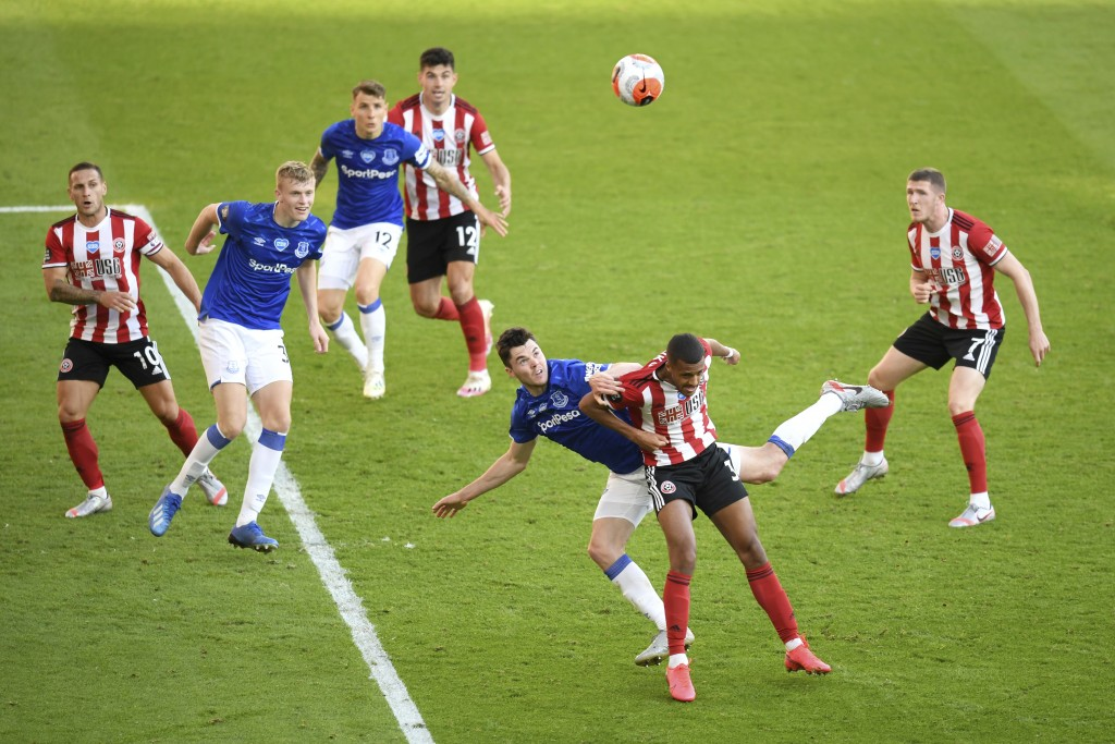 Everton's Michael Keane, center left, defends against Sheffield United's Richairo Zivkovic during the English Premier League soccer match between Shef...