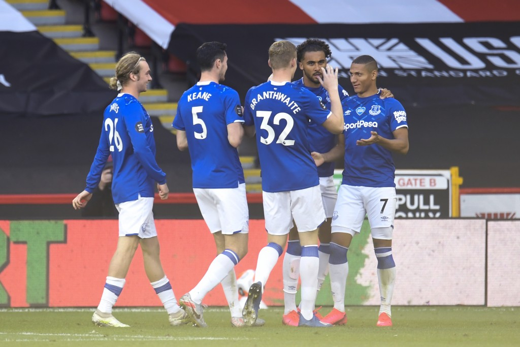 Everton's Richarlison (7) is congratulated by teammates after scoring a goal against Sheffield United during the English Premier League soccer match b...