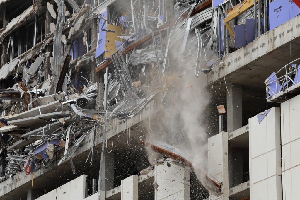 A wrecking ball knocks debris loose from the Hard Rock Hotel building collapse site in New Orleans, Monday, July 20, 2020. New Orleans' fire chief say...