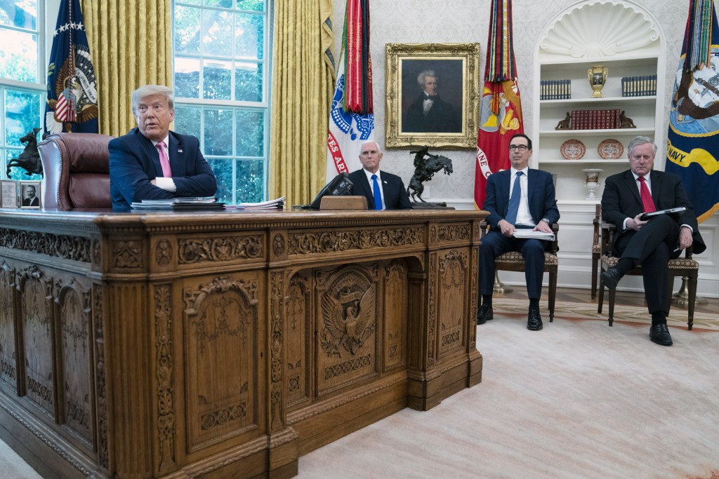 President Donald Trump speaks during a meeting with Senate Majority Leader Mitch McConnell of Ky., and House Minority Leader Kevin McCarthy of Calif.,...