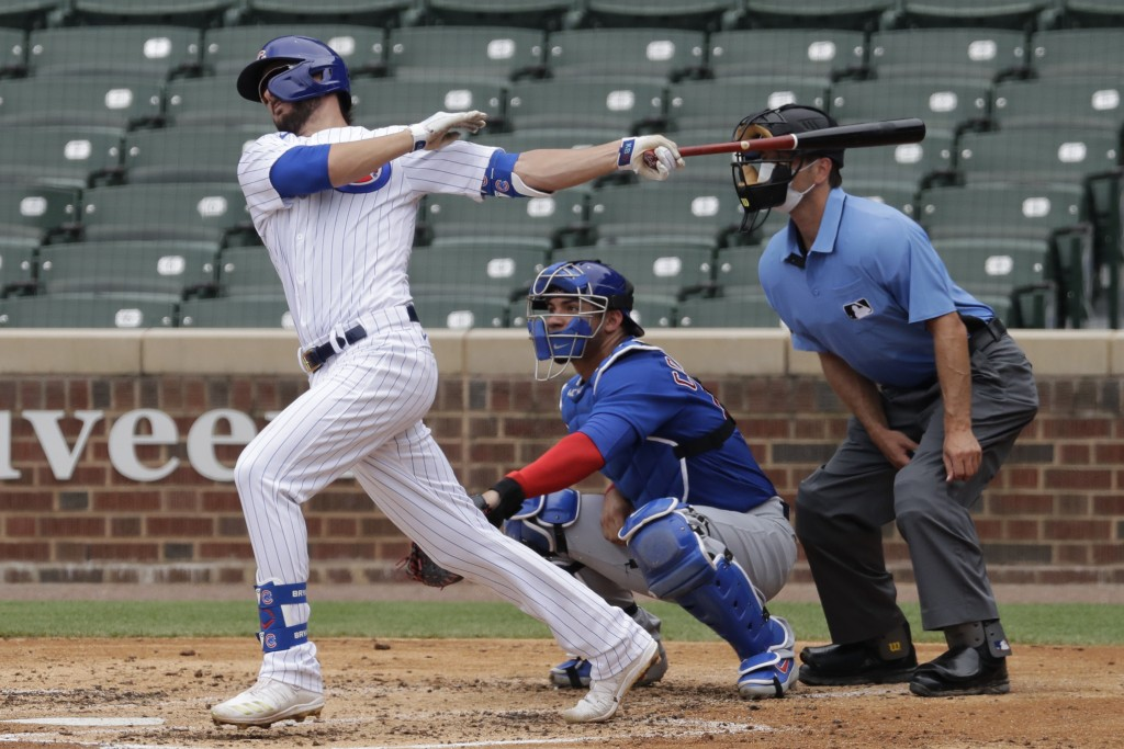FILE - In his July 15, 2020, file photo, Chicago Cubs' Kris Bryant, left, hits a one-run single during an intrasquad baseball game at Wrigley Field in...