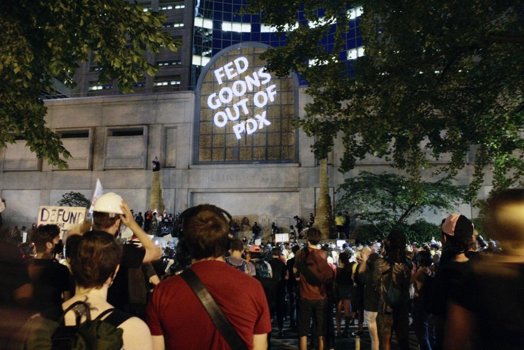 Protesters projected these words on the front of the Multnomah County Justice Center, Monday, July 20, 2020 in Portland, Ore (AP Photo/Gillian Flaccus...