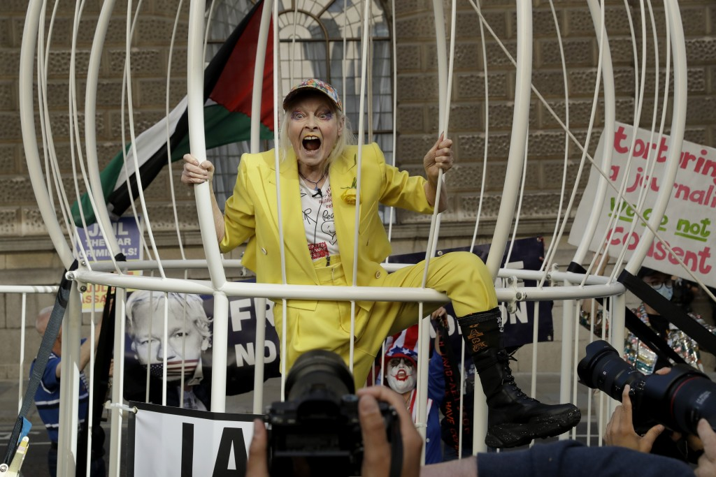 Fashion designer Vivienne Westwood stands in a giant bird cage in protest against the extradition of WikiLeaks founder Julian Assange to the U.S., out...