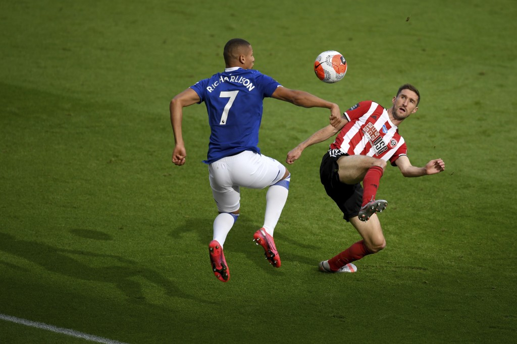 Everton's Richarlison (7) and Sheffield United's Chris Basham compete for the ball during the English Premier League soccer match between Sheffield Un...