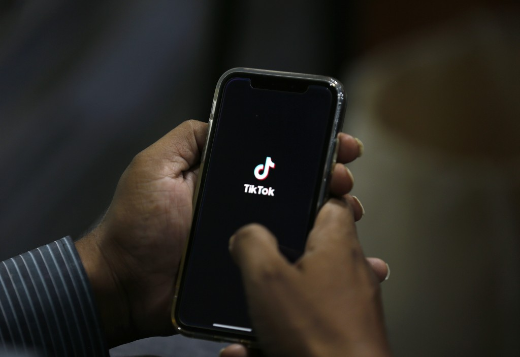 A man opens social media app 'Tik Tok' on his cell phone, in Islamabad, Pakistan, Tuesday, July 21, 2020. Pakistan has threatened the China-linked Tik...