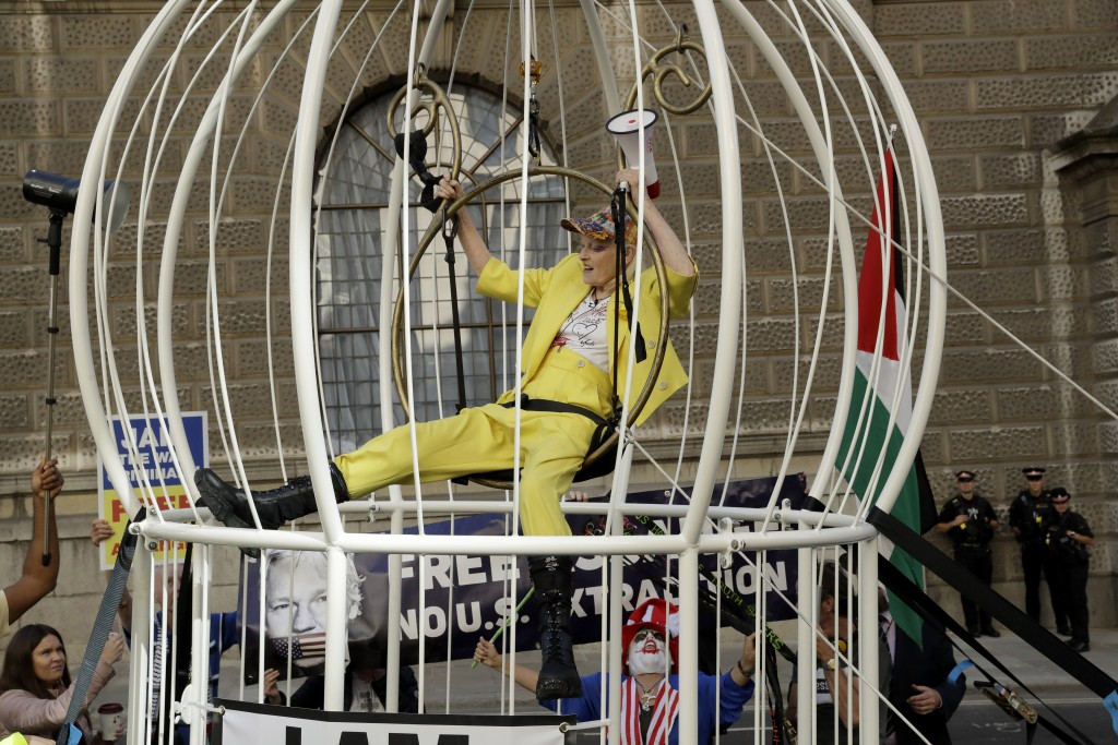 Fashion designer Vivienne Westwood sits suspended in a giant bird cage in protest against the extradition of WikiLeaks founder Julian Assange to the U...