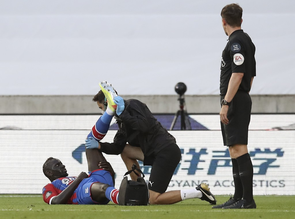 Crystal Palace's Mamadou Sakho receives treatment during the English Premier League soccer match between Wolverhampton Wanderers and Crystal Palace at...