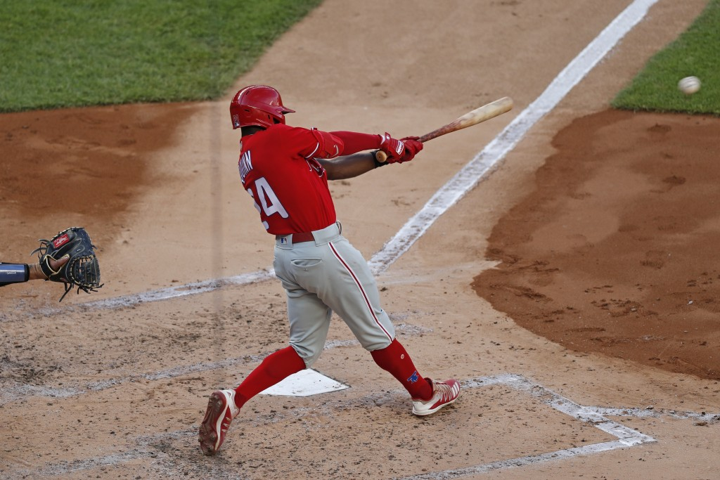 Philadelphia Phillies Roman Quinn hits an RBI single during the second inning of an exhibition baseball game against the New York Yankees, Monday, Jul...