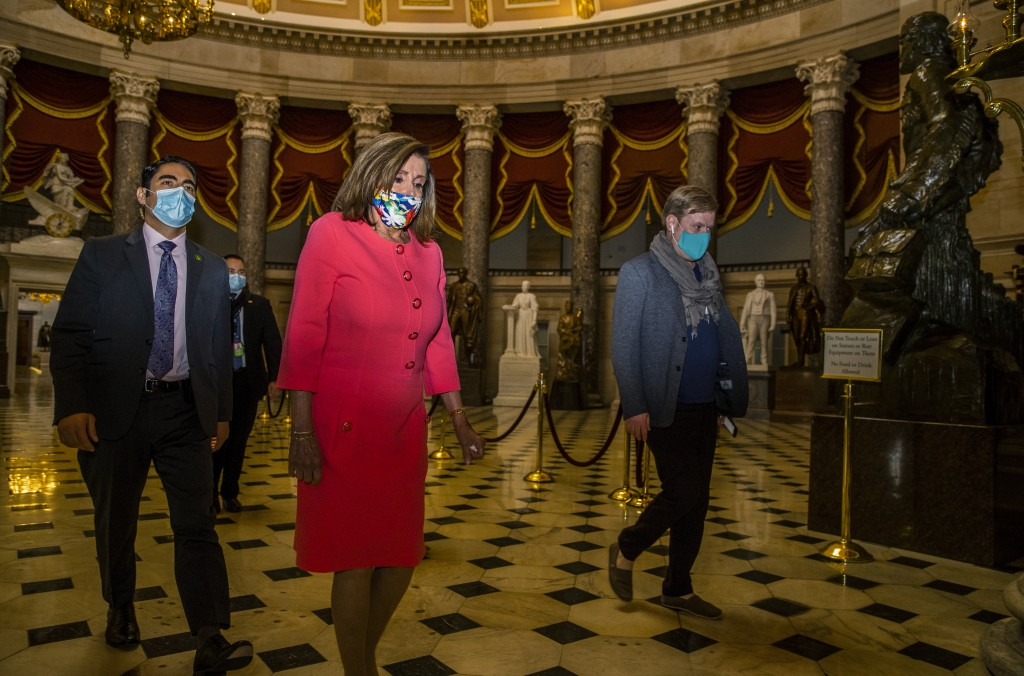 House Speaker Nancy Pelosi walks towards the House Chamber at the Capitol, Monday, July 20, 2020, in Washington. Pelosi, who presided over a moment of...