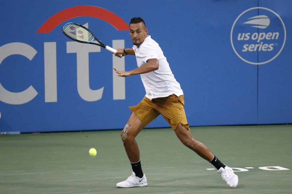 FILE - In this Saturday, Aug. 3, 2019, file photo, Nick Kyrgios, of Australia, returns the ball to Stefanos Tsitsipas, of Greece, during a semifinal a...