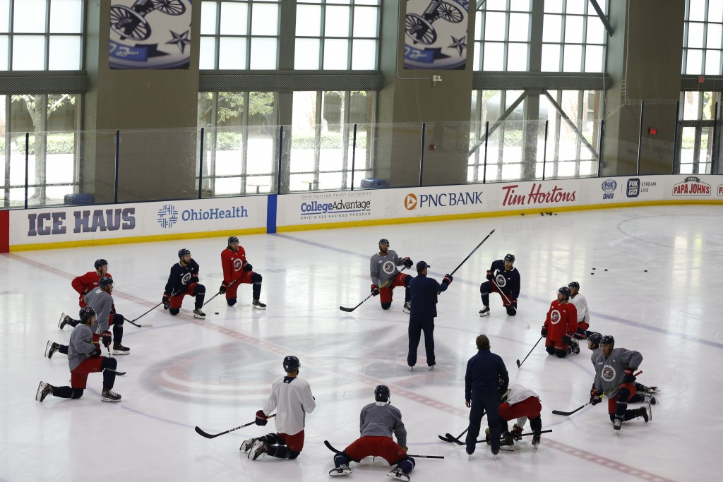 Columbus Blue Jackets' coaches talk with players during the NHL hockey team's practice Monday, July 20, 2020, in Columbus, Ohio. (AP Photo/Jay LaPrete...