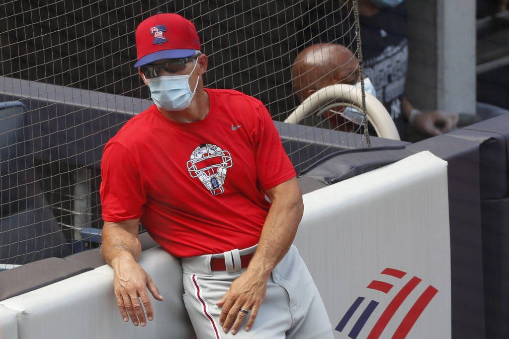 Philadelphia Phillies manager Joe Girardi leans against the stands during batting practice before an exhibition baseball game against his former team,...