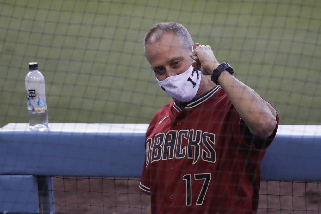 Arizona Diamondbacks manager Torey Lovullo gestures in the dugout during an exhibition baseball game against the Los Angeles Dodgers Monday, July 20, ...