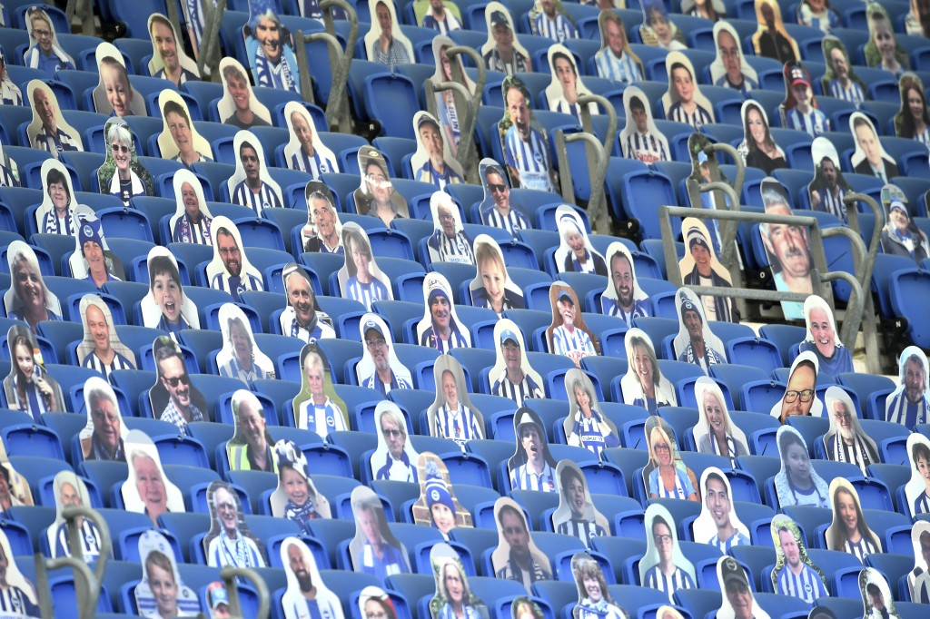 Cutout photos of Brighton fans fill the empty stands during the English Premier League soccer match between Brighton and Newcastle United at the Ameri...