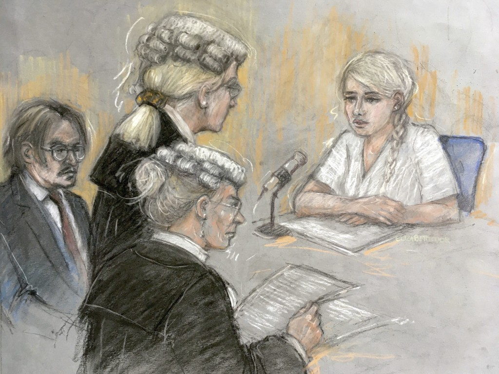 In this court artist sketch by Elizabeth Cook, actress Amber Heard being being cross-examined by Eleanor Laws as she gives evidence at the High Court ...