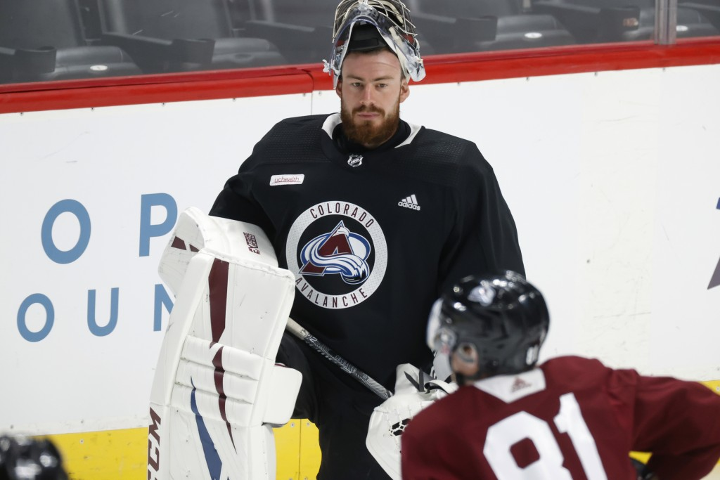 Colorado Avalanche goaltender Philipp Grubauer takes part in drills during an NHL hockey practice Monday, July 20, 2020, in Denver. (AP Photo/David Za...