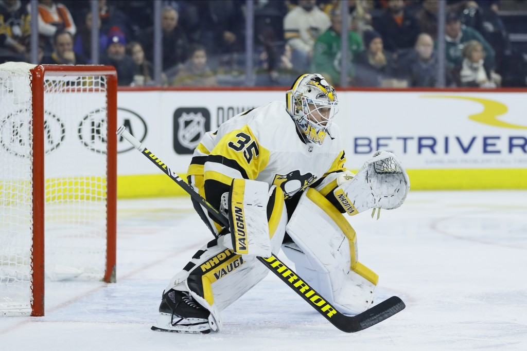 FILE - In this Tuesday, Jan. 21, 2020, file photo, Pittsburgh Penguins' Tristan Jarry plays during an NHL hockey game against the Philadelphia Flyers,...
