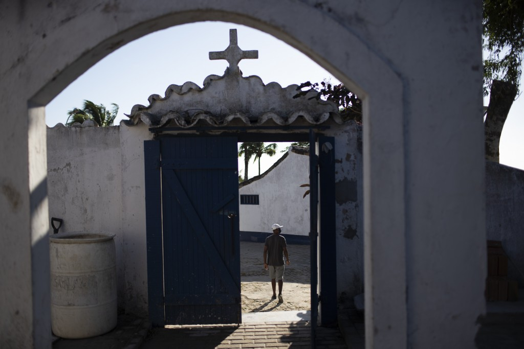 Eduardo Oliveira Costa leaves the Sant'Anna cemetery, where his mother Carivaldina Oliveira da Costa, also known as Aunt Uia, who died from COVID-19 r...