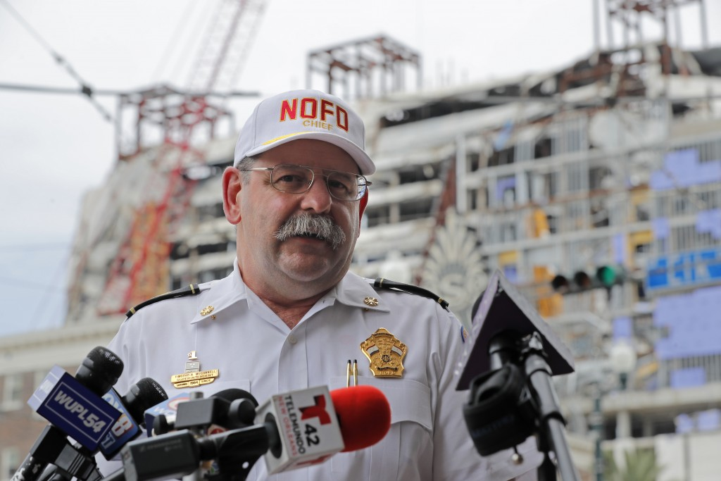 New Orleans Fire Superintendant Fire Superintendent Tim McConnell delivers an update to media for the Hard Rock Hotel building collapse site, seen in ...