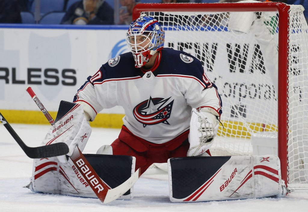 FILE - In this Wednesday, Sept. 25, 2019, file photo, Columbus Blue Jackets goalie Elvis Merzlikins (90) makes a save during the first period of an NH...