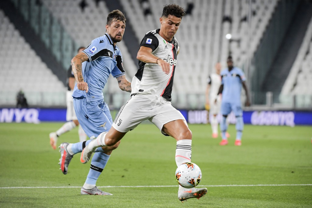 Juventus' Cristiano Ronaldo, right, and Lazio's Francesco Acerbi battle for the ball during the Italian Serie A soccer match between Juventus and Lazi...