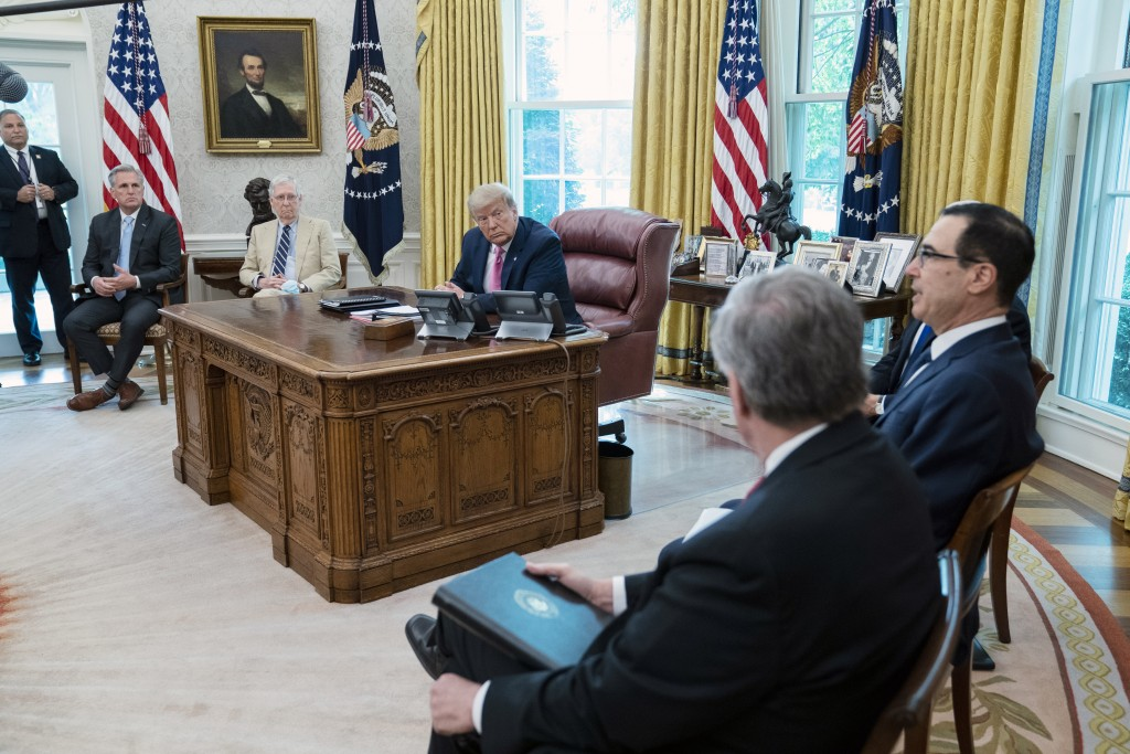President Donald Trump, Senate Majority Leader Mitch McConnell of Ky., and House Minority Leader Kevin McCarthy of Calif., listen as Treasury Secretar...