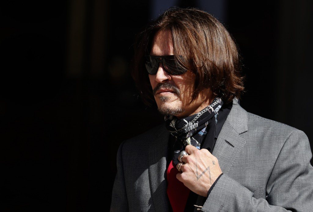 US Actor Johnny Depp arrives at the High Court in London, Tuesday, July 21, 2020. Actor Johnny Depp is suing News Group Newspapers, publisher of The S...