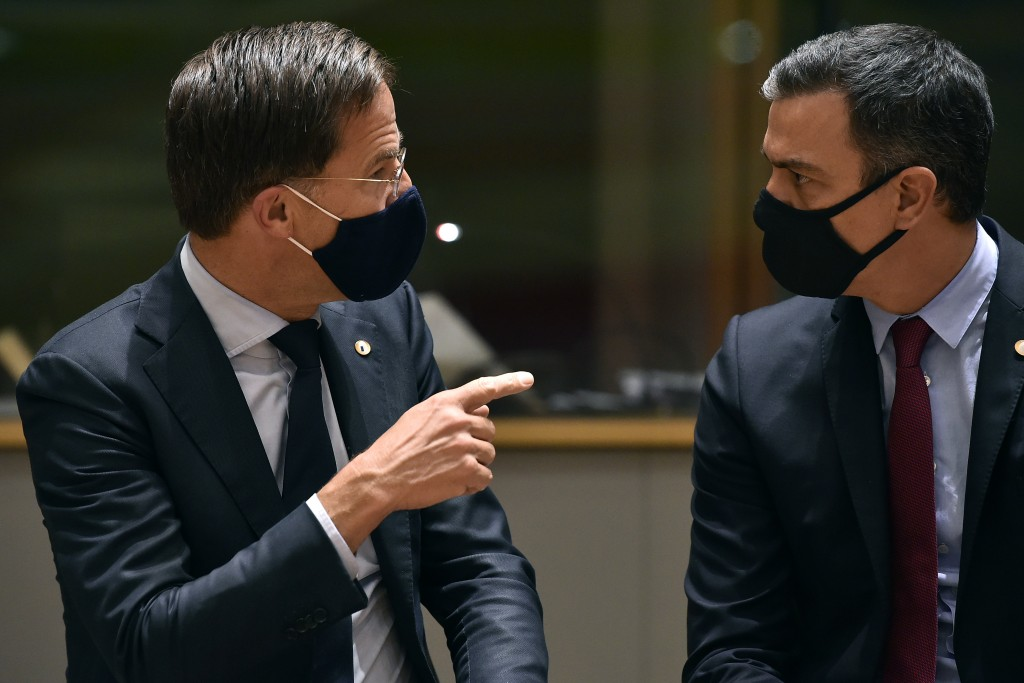 Dutch Prime Minister Mark Rutte, left, speaks with Spain's Prime Minister Pedro Sanchez during a round table meeting at an EU summit in Brussels, Mond...