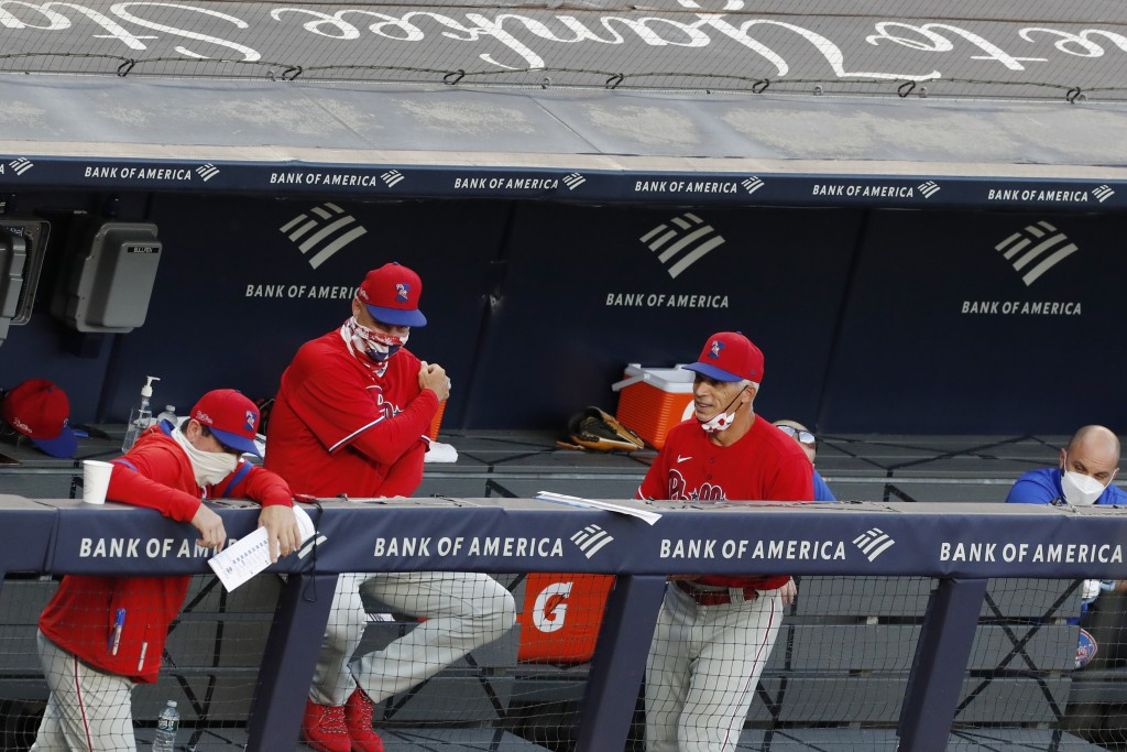 Philadelphia Phillies manager Joe Girardi, third from right, talks to his coaches during an exhibition baseball game against his former team, the New ...