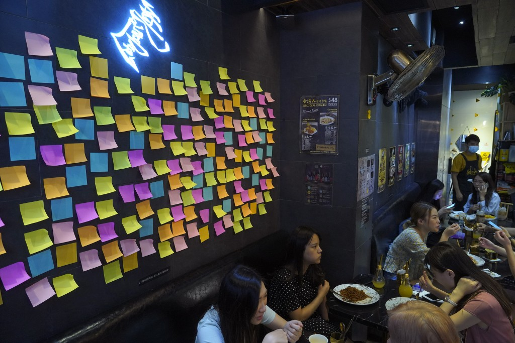 """A Hong Kong Cafe, known as a """"yellow shop"""" because its owners expressed sympathy for protesters, has a wall decorated with blank post-it notes in Hong..."""